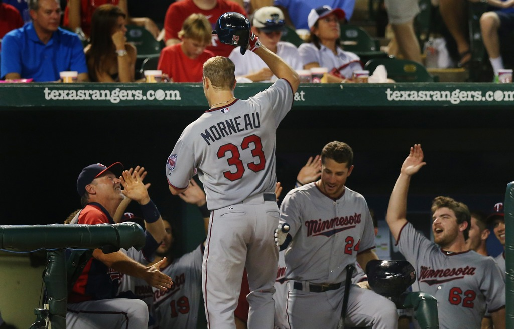 . Minnesota\'s Justin Morneau celebrates what would be the last of his 221 career home runs as a Twin, this one off Texas starter Yu Darvish, in the seventh inning at Rangers Ballpark in Arlington, TX on Friday August 30, 2013. Morneau\'s solo shot proved to be the winning run in Minnesota\'s 3-2 win.  (Photo by Ronald Martinez/Getty Images)