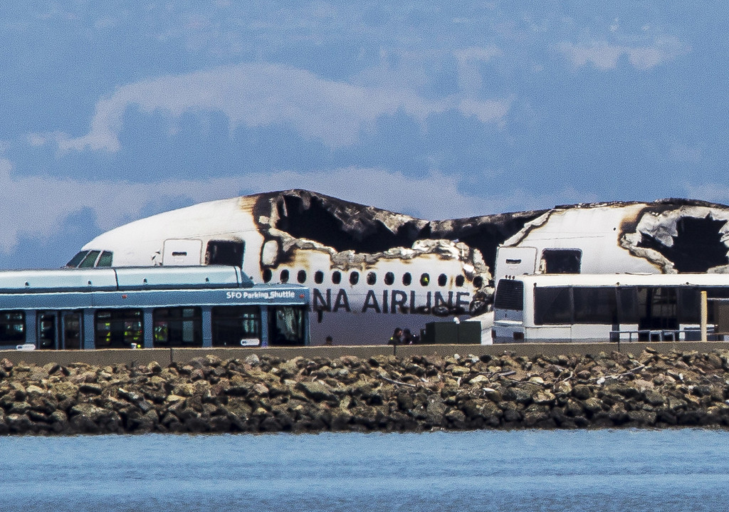 . The remains of a  Boeing 777 airplane sits on a tarmac after having crashed while landing at San Francisco International Airport July 6, 2013 in San Francisco, California. A passenger aircraft from Asiana Airlines coming from Seoul, South Korea crashed landed while on it\'s decent. No word so far on injuries or deaths. (Photo by Kimberly White/Getty Images)