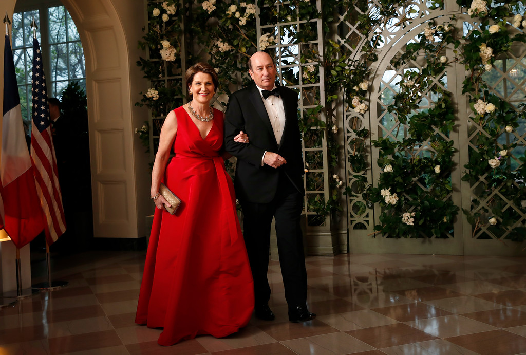 . Marillyn Hewson, the CEO of Lockheed Martin, and James Hewson arrives for a State Dinner with French President Emmanuel Macron and President Donald Trump at the White House, Tuesday, April 24, 2018, in Washington. (AP Photo/Alex Brandon