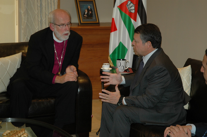 His Majesty King Abdullah II of Jordan, right, addresses ELCA Presiding Bishop Mark Hanson during an audience with the Jordanian monarch Jan. 6 in Amman.  ELCIC Bishop Susan Johnson and ELCJHL Bishop Munib Younan also attended.