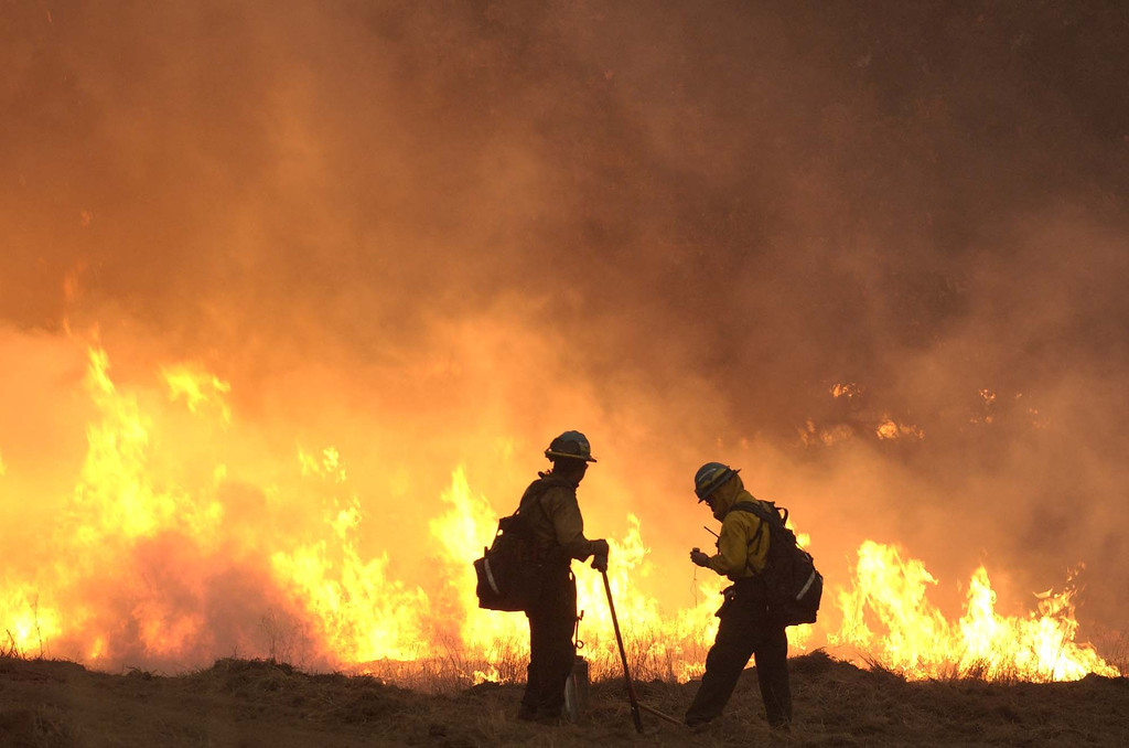 . Members of the  Navajo hot shots fire crew lights a back fire  to head off the front of the Cedar fire just outside Julian, Calif. Tuesday, October 28, 2003. (AP Photo/Tim Tadder)