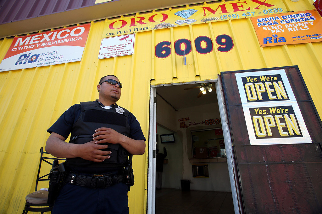 . Willie Barrera, of J& E Private Security, guards a business along International Boulevard near Seminary Avenue in Oakland, Calif., on Friday, April 12, 2013. (Jane Tyska/Staff)