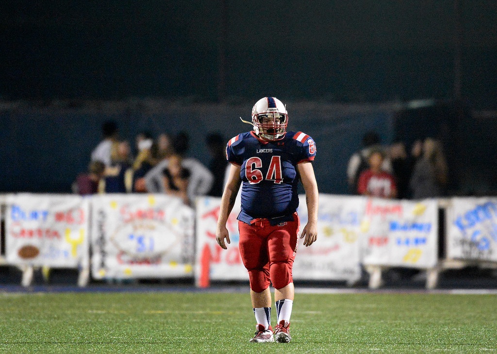 . La Salle\'s Jason Young (64) finds his position as they play Bishop Montgomery during the second quarter in Friday night\'s football game at La Salle High School in Pasadena, October 25, 2013.  (Photo by Sarah Reingewirtz/Pasadena Star-News)