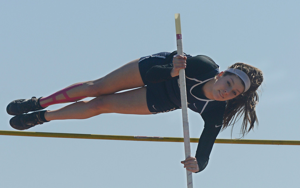 """. Maribeth Joeright/MJoeright@News-Herald.com West Geauga\'s Audrey Rabe clears 11 ft in the girls pole vault event during the Hilltopper Invitational track meet, April 12, 2014. Rabe won the event and then successfully vaulted at a height of 11\'7\"""" and establishing a meet and area record."""