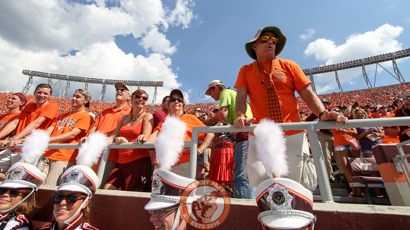 A Virginia Tech fan heckles the ECU bench from the first row.  (Mark Umansky/TheKeyPlay.com)