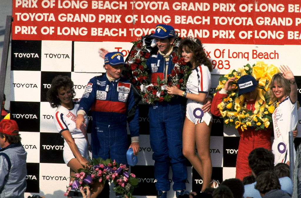 . Niki Lauda, left, with teammate and race winner John Watson, both of Team McLaren, at the Long Beach Toyota Grand Prix on March 27,1983. (AP Photo/stf)