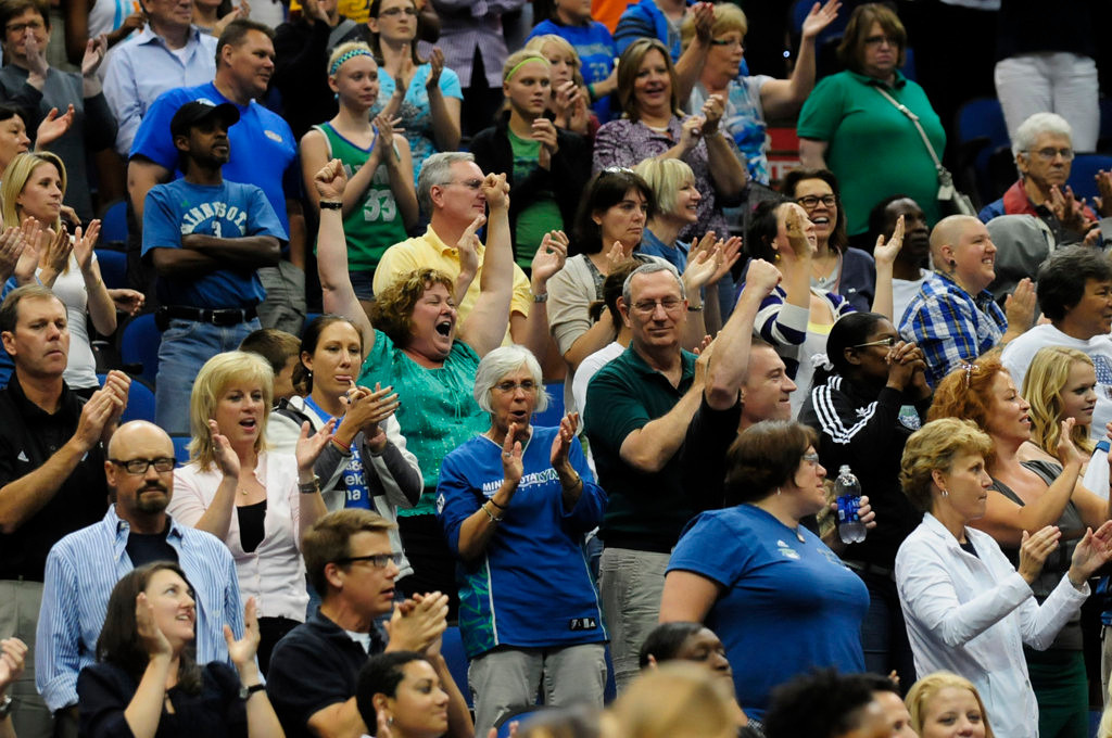 . Minnesota fans celebrate after Seimone Augustus sinks a jumper with 36 seconds left  in the second half to tie the game.(Pioneer Press: Scott Takushi)