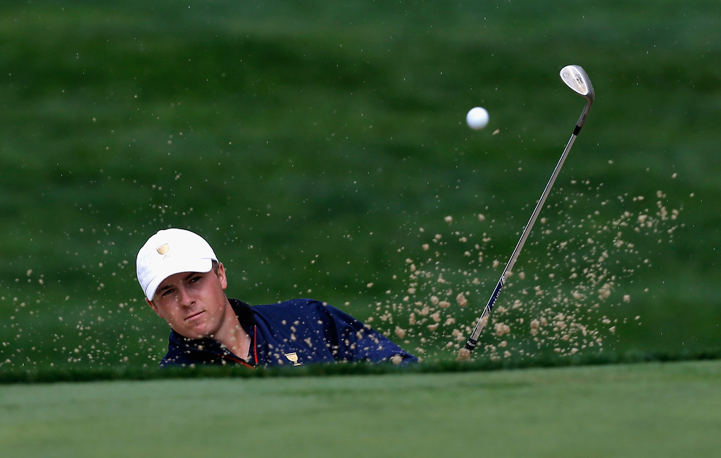 . DUBLIN, OH - OCTOBER 03:  Jordan Spieth of the U.S. Team hits a bunker shot on the seventh hole during the Day One Four-Ball Matches at the Muirfield Village Golf Club on October 3, 2013  in Dublin, Ohio.  (Photo by Matt Sullivan/Getty Images)