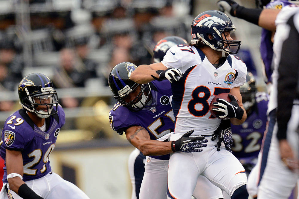 Description of . Denver Broncos wide receiver Eric Decker #87 picks up 5 yards with this catch against the Baltimore Ravens at the M&T Bank Stadium, in Baltimore , MD Sunday December 16, 2012.      Joe Amon, The Denver Post