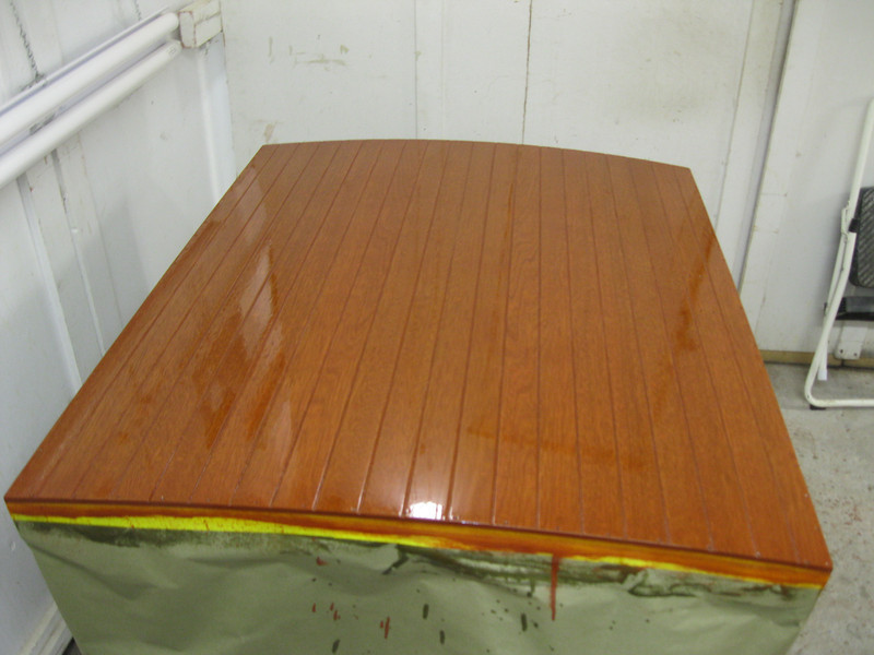 Engine hatch cover with six coats of varnish applied.