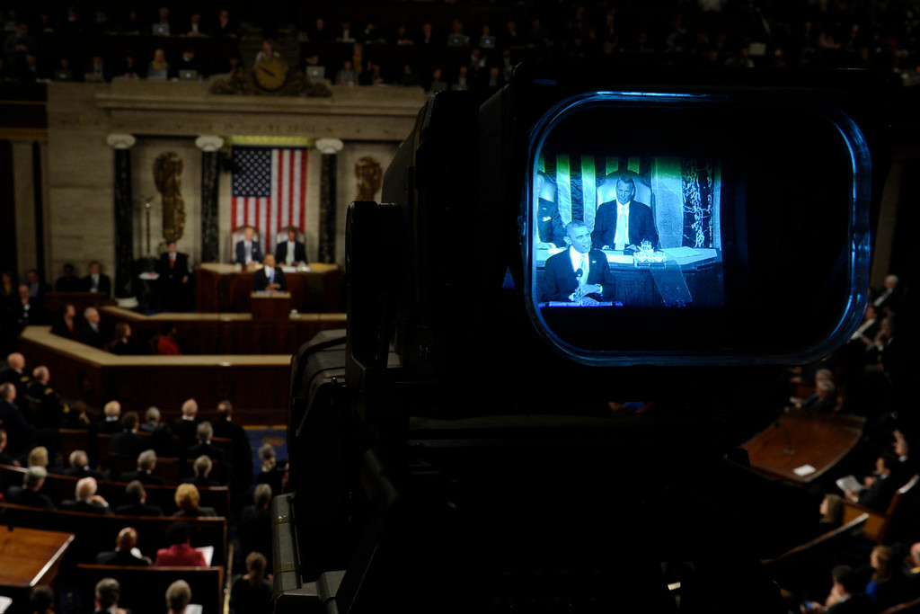 . President Barack Obama is seen through a television camera viewfinder as gives his the State of the Union address on Capitol Hill in Washington, Tuesday Jan. 28, 2014. (AP Photo/Susan Walsh)