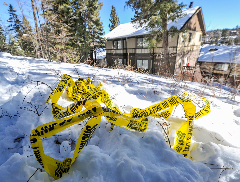 . Sheriff\'s crime scene tape is left in the snow near a condo on Club View Drive where fugitive ex-cop Christopher Dorner allegedly stayed for an unknown during while multiple law enforcement agencies searched the mountain area in Big Bear on Wednesday, Feb. 13, 2013. The Sheriff\'s command post near Bear Mountain Resort was established directly across the street from the condo. (Rachel Luna / Staff Photographer)