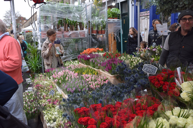 flower stall with people milling about