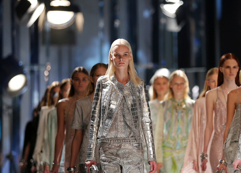. Models wears creations for Roberto Cavalli women\'s Spring-Summer 2014 collection, part of the Milan Fashion Week, unveiled in Milan, Italy, Saturday, Sept. 21, 2013. (AP Photo/Antonio Calanni)