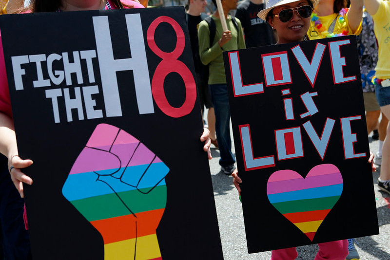 . Revelers, holding placards, march against Prop 8 in support of marriage equality during the 43rd annual L.A. LGBT Pride Parade in West Hollywood, California June 9, 2013. The parade celebrates the lesbian, gay, bisexual and transgender communities in Los Angeles. REUTERS/Patrick T. Fallon
