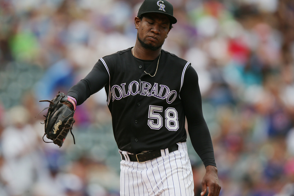 . Colorado Rockies starting pitcher Yohan Flande reacts after giving up a solo home run to Chicago Cubs\' Javier Baez in the sixth inning of the Cubs\' 6-2 victory in a baseball game in Denver on Thursday, Aug. 7, 2014. (AP Photo/David Zalubowski)