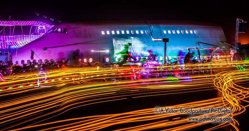An 11-second exposure of bicycles passing the 747.
