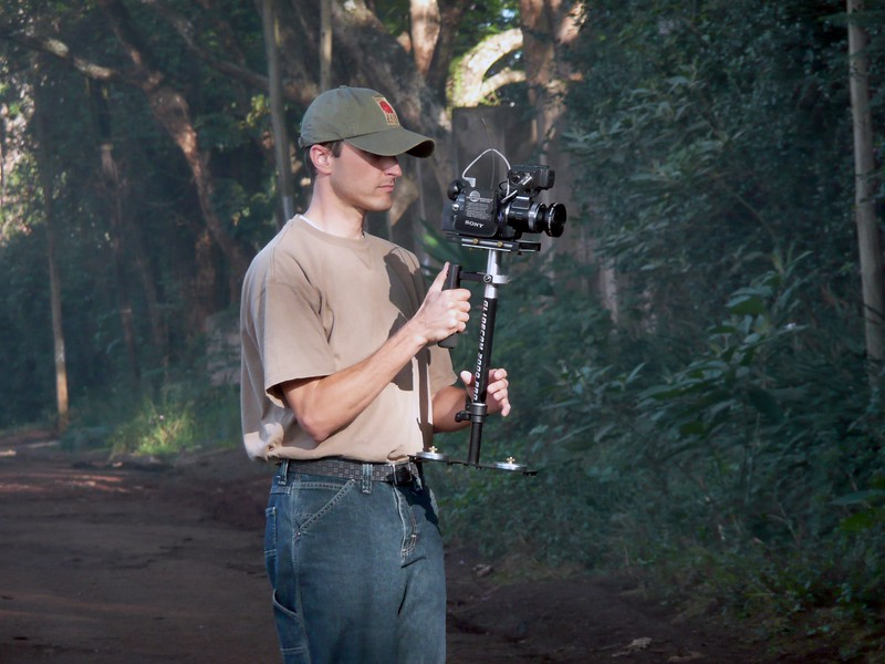 Mike Delorenzo films with the Glidecam during a walking interview for the Tumaini video  OFM team
