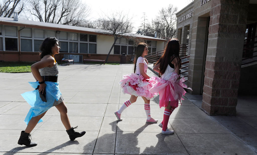 . From left, Ale Velez, Kimmy Yoder and Jenna Zamora walk to the Performing Arts Center in their creations for the third annual Paper Skirt Fashion Show held at Liberty High School in Brentwood, Calif.  on Tuesday, Jan. 29, 2013. (Susan Tripp Pollard/Staff)