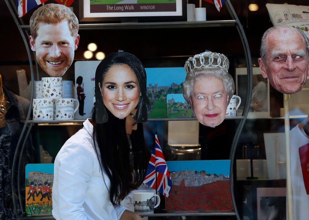 . A shop assistant decorates a shop window in Windsor, England, Tuesday, May 15, 2018.  Preparations continue in Windsor ahead of the royal wedding of Britain\'s Prince Harry and Meghan Markle Saturday May 19. (AP Photo/Frank Augstein)