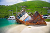 Sunk tug boat on the shoreline of a beautiful tropical island.
