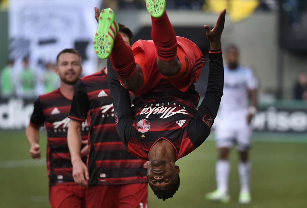 . Portland Timbers forward Dairon Asprilla flips after scoring a goal during the second half of an MLS soccer game against the Vancouver Whitecaps in Portland, Ore., on Sunday, May 22, 2016. (AP Photo/Steve Dykes)