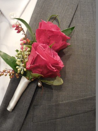 double dark pink rose , pieri and mixed  greens $25