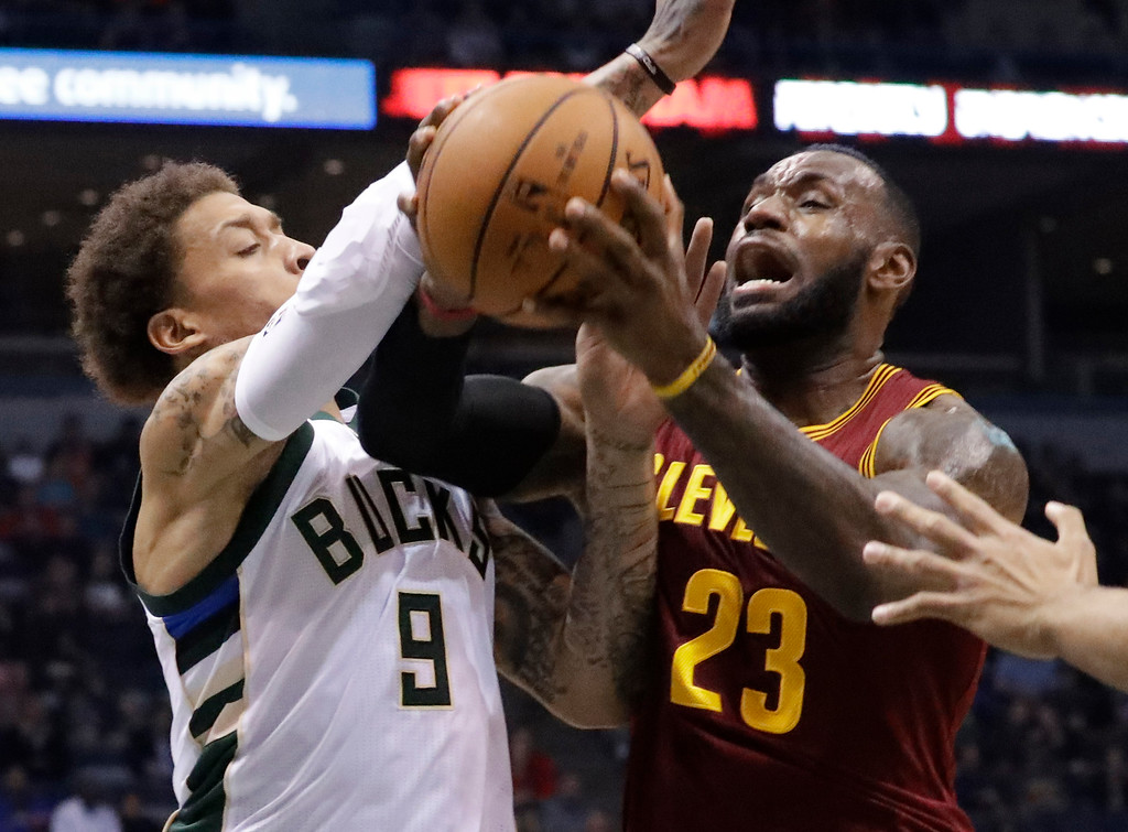 . Cleveland Cavaliers\' LeBron James is fouled as he tries to drive past Milwaukee Bucks\' Michael Beasley during the first half of an NBA basketball game Tuesday, Nov. 29, 2016, in Milwaukee. (AP Photo/Morry Gash)
