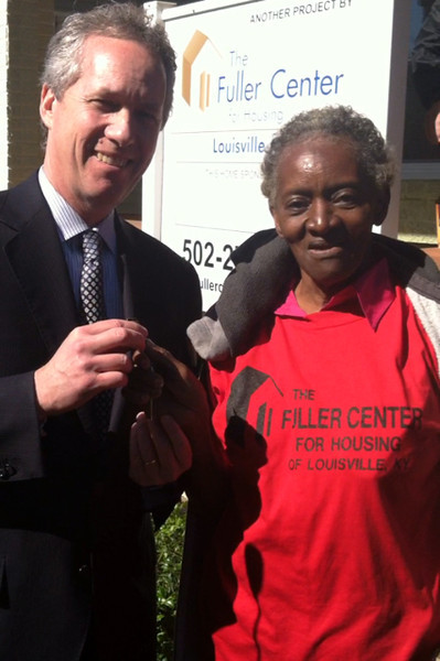 Louisville Mayor Greg Fischer presents Carolyn Mayes with the keys to her home that was refurbished through The Fuller Center's Save a House/Make a Home initiative. 4-18-2012