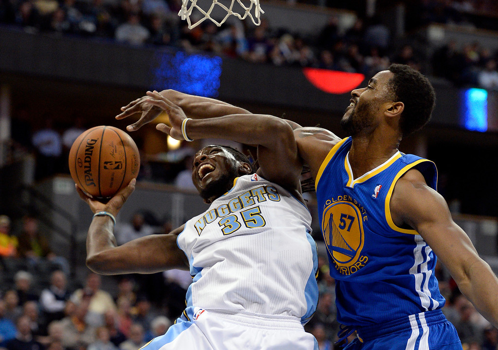 . DENVER, CO - APRIL 16: Denver Nuggets forward Kenneth Faried (35) gets gets fouled by Golden State Warriors forward Hilton Armstrong (57) as he goes up for a shot during the first quarter April 16, 2014 at Pepsi Center. (Photo by John Leyba/The Denver Post)