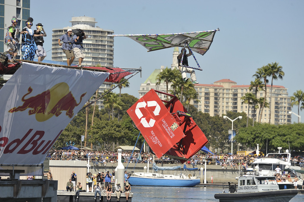 """. LONG BEACH, CALIF. USA -- Juan Ramires pilots his team\'s Flugtag entry \""""Green Machine\"""" in Rainbow Harbor in Long Beach, Calif. on August 21, 2010. Thirty five teams competed in the Red Bull event where teams build homemade, human-powered flying machines and pilot them off a 30-foot high deck in hopes of achieving flight.  Flugtag means \""""flying day\"""" in German. They are on distance, creativity and showmanship..Photo by Jeff Gritchen / Long Beach Press-Telegram.."""