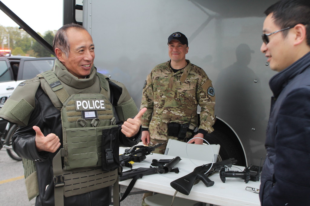 . Kristi Garabrandt � The News-Herald <br> Fu Men , China gives his son Jason Men of Mentor the thumbs up as he excitedly tries on the tactical gear used by Mentor SWAT Department during the 36th Annual Heroes Day held at Great Lakes Mall, May 12, 2018.