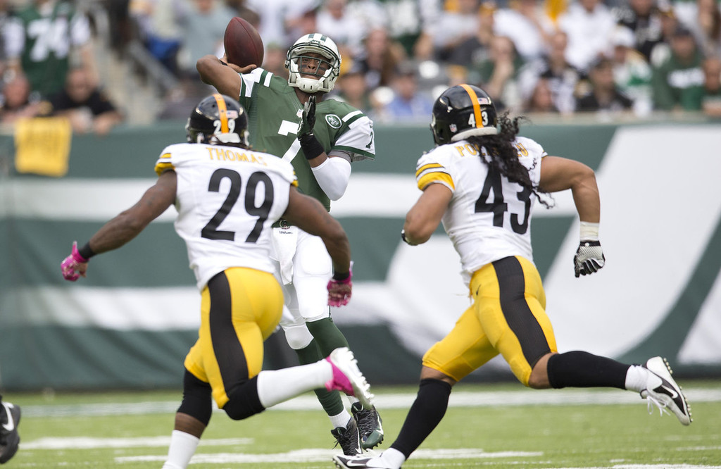 . Quarterback Geno Smith #7 of the New York Jets throws the ball against the Pittsburgh Steelers on October 13, 2013 at MetLife Stadium in East Rutherford, New Jersey. (Photo by Mitchell Leff/Getty Images)