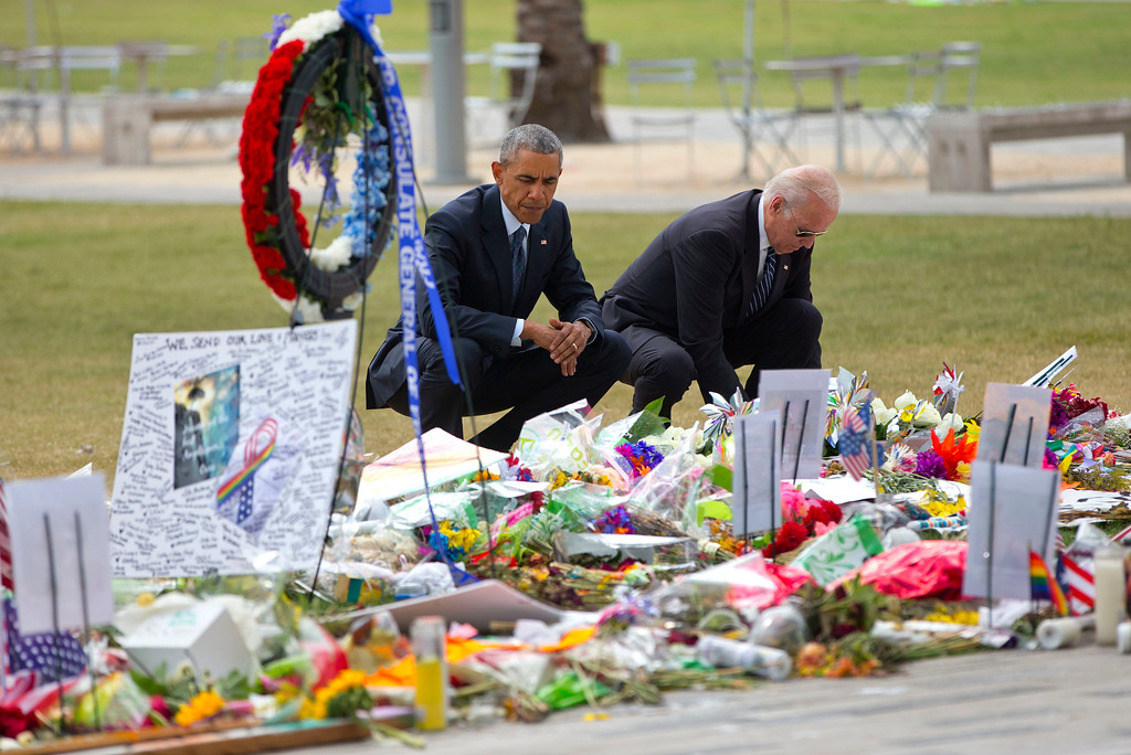 . President Barack Obama and Vice President Joe Biden visit a memorial to the victims of the Pulse nightclub shooting, Thursday, June 16, 2016 in Orlando, Fla. Offering sympathy but no easy answers, Obama came to Orlando to try to console those mourning the deadliest shooting in modern U.S history. (AP Photo/Pablo Martinez Monsivais)