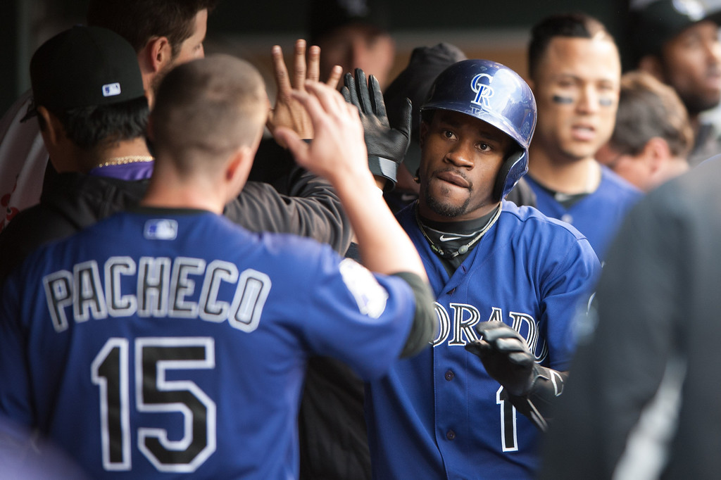 . DENVER, CO - MAY 4:  Eric Young Jr. #1 of the Colorado Rockies celebrates a first inning run against the Tampa Bay Rays at Coors Field on May 4, 2013 in Denver, Colorado. The Rockies led the Rays 1-0 after one inning. (Photo by Dustin Bradford/Getty Images)