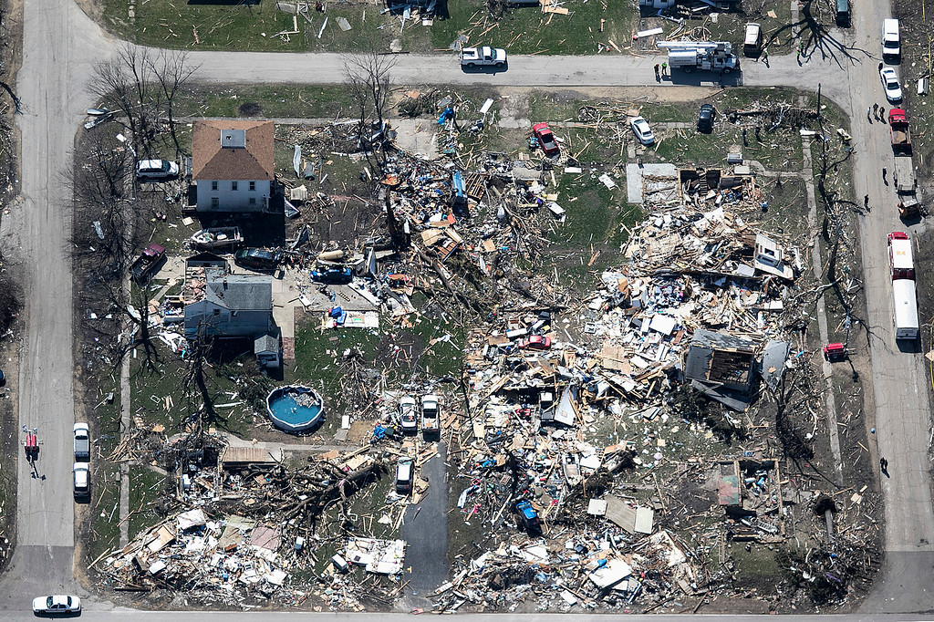 . This aerial photo shows destruction in a section of the small town of Fairdale, Ill., in DeKalb County on Friday, April 10, 2015, after a tornado swept through the area the night before. The National Weather Service says at least two tornadoes churned through six north-central Illinois counties. Illinois Gov. Bruce Rauner on Friday declared DeKalb and Ogle counties affected by the severe storms and tornadoes as disaster areas.  (AP Photo/Daily Chronicle, Danielle Guerra)