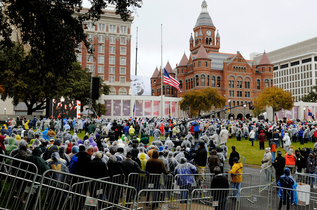 . A crowd gathers before a ceremony to mark the 50th anniversary of the assassination of John F. Kennedy, Friday, Nov. 22, 2013, at Dealey Plaza in Dallas. President Kennedy\'s motorcade was passing through Dealey Plaza when shots rang out on Nov. 22, 1963. (AP Photo/Benny Snyder)