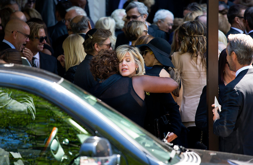 . Deborah Norville is embraced after a funeral service for comedian Joan Rivers at Temple Emanu-El in New York Sunday, Sept. 7, 2014. Rivers died Thursday at 81. (AP Photo/Craig Ruttle)