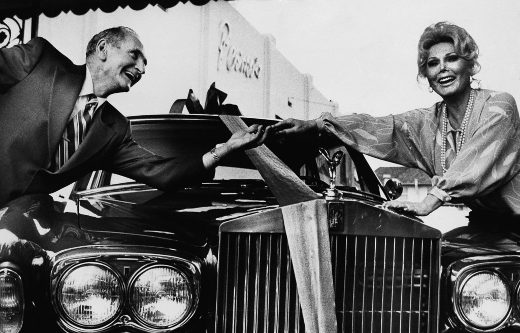 . Nealy Wilson, from Charleston, South Carolina won Zsa Zsa Gabor\'s $61,000 Rolls Royce in a nation-wide sweepstakes contest, and he gets the keys to the car in Los Angeles on Thursday, April 6, 1978 from Zsa Zsa herself.      (AP Photo/George Brich)