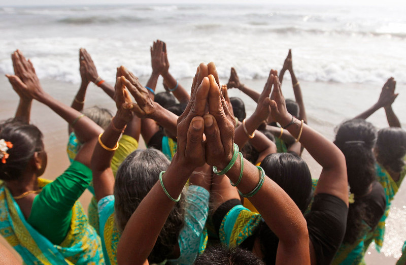 . Indian women offer prayers on the Marina Beach at the Bay of Bengal to commemorate the 10th anniversary of the 2004 Tsunami in Chennai, India, Friday, Dec. 26, 2014. Crying onlookers took part in beachside memorials and religious services across Asia on Friday to mark the 10th anniversary of the Indian Ocean tsunami that left more than a quarter million people dead in one of modern history\'s worst natural disasters. (AP Photo/Arun Sankar K)