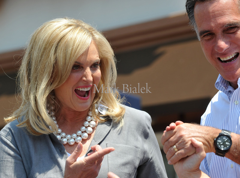 Ann and Mitt Romney are introduced to a crowd of several hundred supporters at a campaign stop in DeWitt, MI on June 19, 2012.  After speaking, Mitt stepped into the Sweetie-Licious Cafe & Bakery for some pie.  It was one of several campaign stops in Michigan.