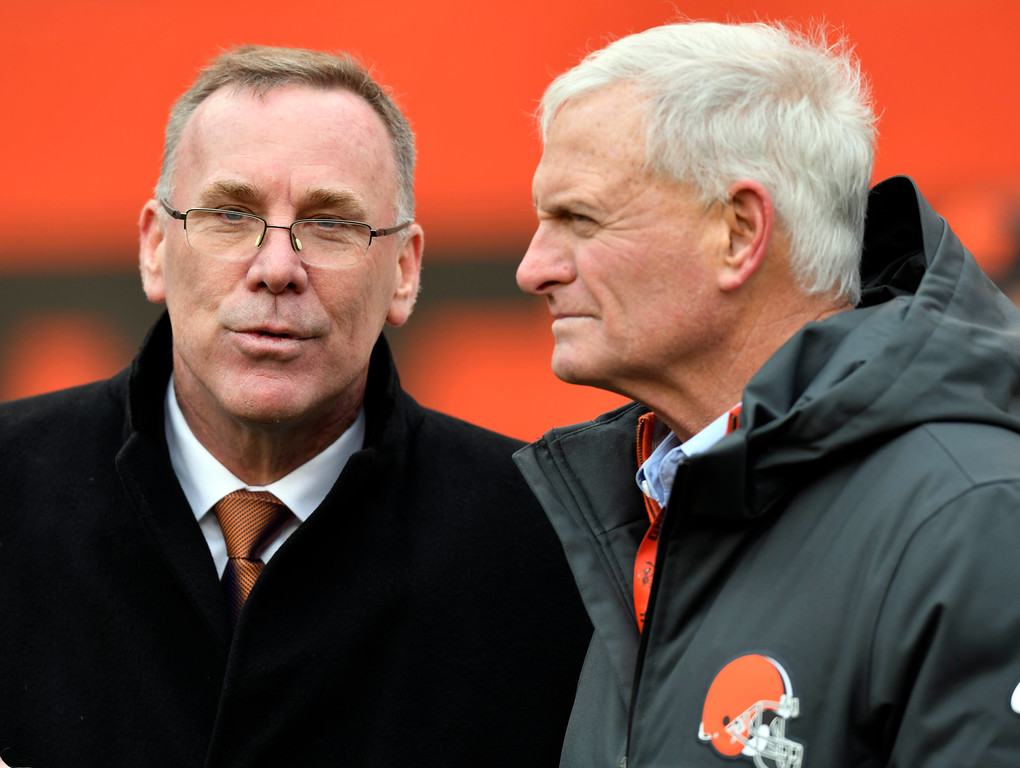 . Cleveland Browns general manager John Dorsey, left, talks with owner Jimmy Haslam before an NFL football game between the Green Bay Packers and the Cleveland Browns, Sunday, Dec. 10, 2017, in Cleveland. (AP Photo/David Richard)