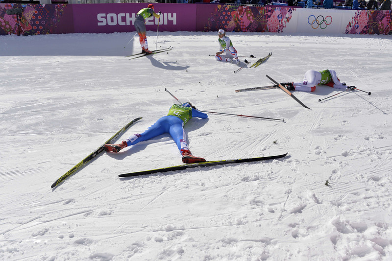 . Italy\'s Gaia Vuerich and Canada\'s Daria Gaiazova (R 6-2)  lie on the snow after crossing the finish line in the Women\'s Cross-Country Skiing Team Sprint Classic Semifinals at the Laura Cross-Country Ski and Biathlon Center during the Sochi Winter Olympics on February 19, 2014 in Rosa Khutor near Sochi. (ODD ANDERSEN/AFP/Getty Images)