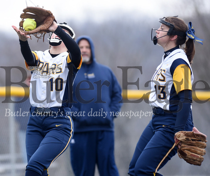 Harold Aughton/Butler Eagle: Mars third baseman, Olvia Waldrop, catches a foul ball as her sister, Emilee watches.