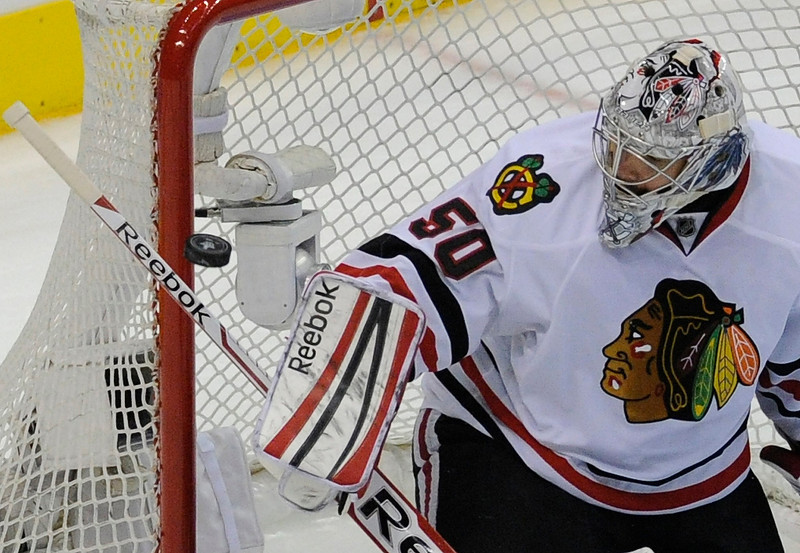 . Blackhawks#50 Corey Crawford keeps an eye on a puck that hit the goal post in the 3rd period. The Kings defeated the Chicago Blackhawks in the 3-1 in the 3rd game of the Western Conference Finals. Los Angeles, CA 6/4/2013(John McCoy/LA Daily News4