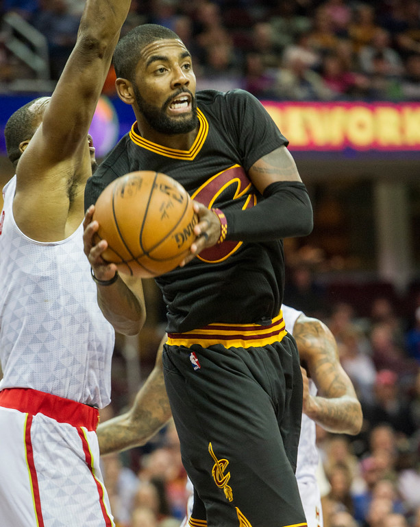 . Cleveland Cavaliers\' Kyrie Irving (2) drives past Atlanta Hawks\' Dwight Howard during the second half of an NBA basketball game in Cleveland, Tuesday, Nov. 8, 2016. The Hawks won 110-106. (AP Photo/Phil Long)