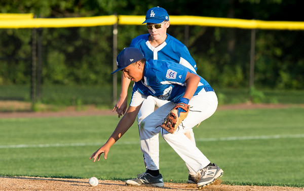08/19/19 Wesley Bunnell | Staff The Forrestville Dodgers vs the McCabe-Waters Astros in the first game of the city series at Breen Field on Monday August 19, 2019. Dodgers Dante DePass (13) bobbles a ground ball.