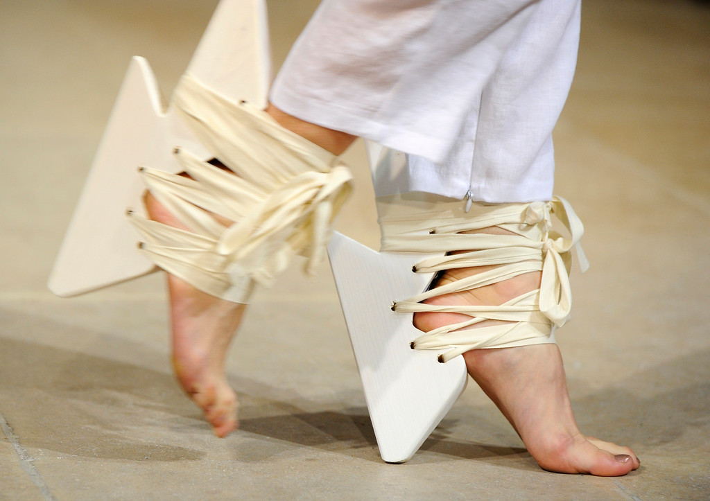 . A model presents shoes for Fatima Lopes\' ready-to-wear Spring/Summer 2014 fashion collection presented in Paris, Tuesday, Oct.1, 2013. (AP Photo/Zacharie Scheurer)