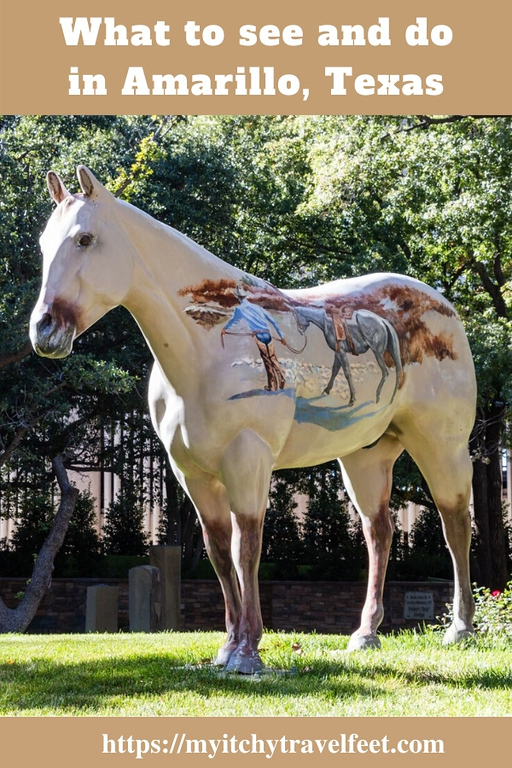 Painted pony statue in a park.