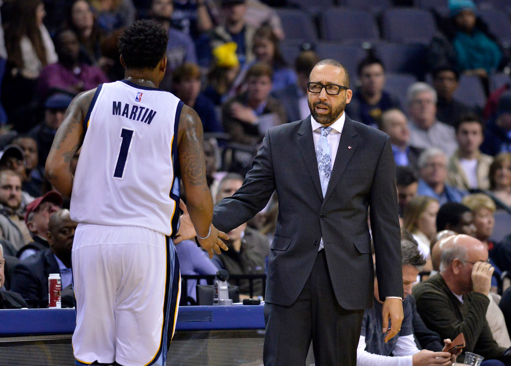 . Memphis Grizzlies head coach David Fizdale, right, greets forward Jarell Martin (1) as he leaves the court in the first half of an NBA basketball game Wednesday, Dec. 14, 2016, in Memphis, Tenn. (AP Photo/Brandon Dill)